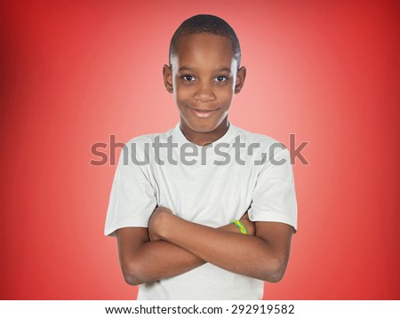 Afroamerican teenager boy on a red background - stock photo