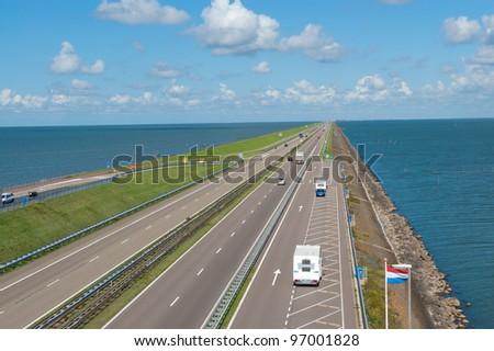 Afsluitdijk dam in Holland (Netherlands). Dam road - stock photo