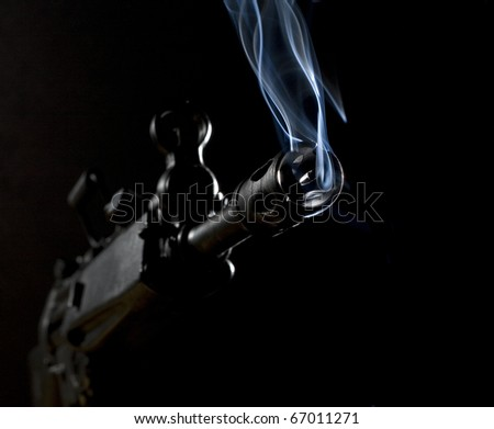 after a shot has been taken in the dark with an assault rifle - stock photo
