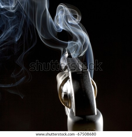 after a single shot is away from a revolver in the night - stock photo
