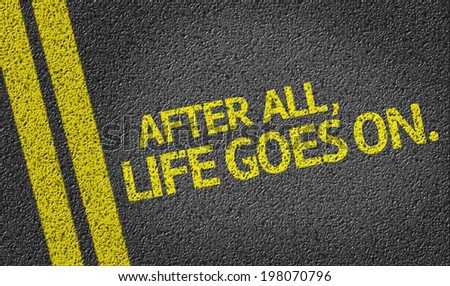 After All, Life Goes On. written on the road - stock photo
