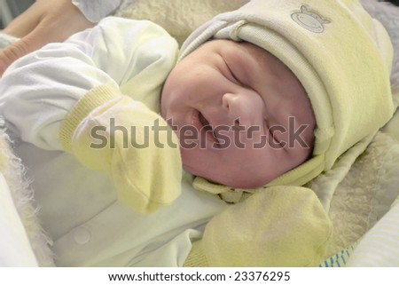 After childbirth, newborn baby in hospital. - stock photo