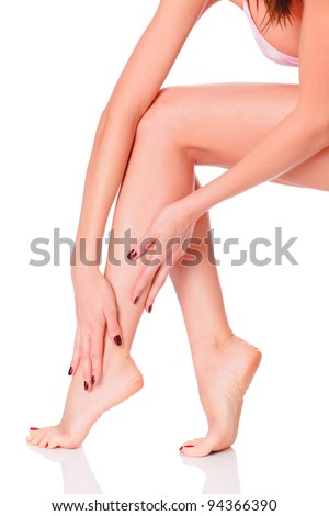 After depilation.  Perfect long female legs against white background - stock photo