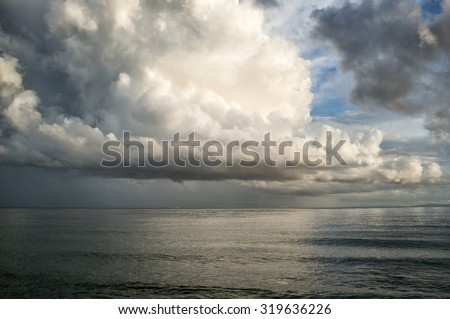 After storm. Spectacular towering white cumulonimbus cloud formation formed in the sky above Atlantic ocean in a weather and nature background - stock photo