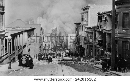AFTER THE EARTH QUAKE, SAN FRANCISCO. Observers in chairs amid the debris on Sacramento Streetwatch the city burn. Photo by Arnold Genthe. - stock photo