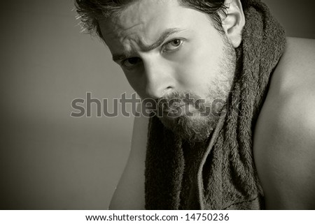 After workout: tired looking man with towel around his neck