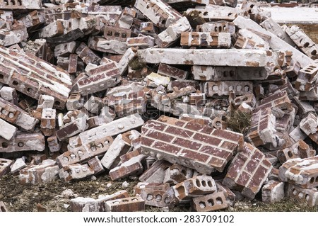 Aftermath of violent storm: Pile of brick rubble from a single-family house destroyed by a tornado in Illinois - stock photo