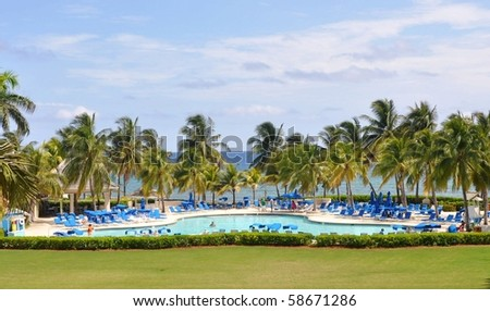 Afternoon at resort pool in Jamaica - stock photo