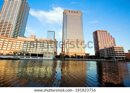 Afternoon in Tampa. City skyline seen accross the river. - stock photo