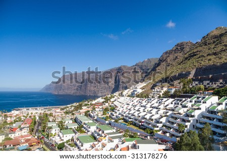 Afternoon landscape of Los Gigantes resort city, Tenerife, Canary Islands, Spain - stock photo