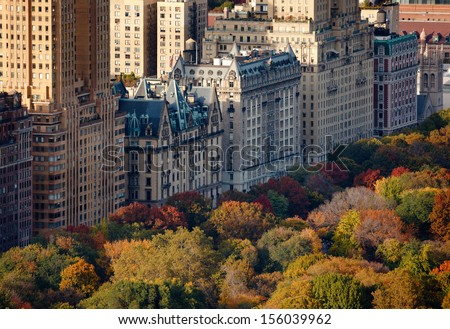 Afternoon light on Central Park's treetops and NYC buildings. Upper West Side building facades and tree colors lit by the autumn sun. - stock photo