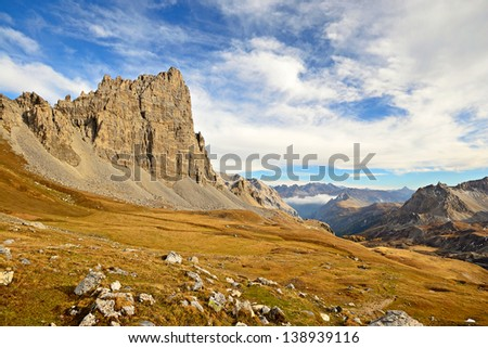 Afternoon light on Le Grand S�©ru peak (2888 m), in an idyllic dolomitic-like high mountain scenery in the italian french Alps. - stock photo
