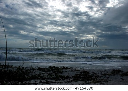 afternoon stormy beach waves clouds Sanibel Florida - stock photo