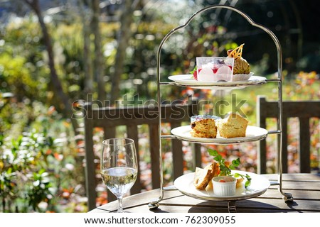 https://thumb9.shutterstock.com/display_pic_with_logo/167494286/762309055/stock-photo-afternoon-tea-in-a-terrace-762309055.jpg