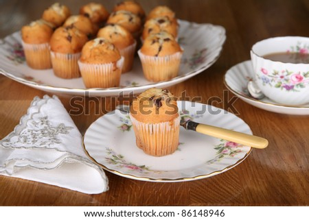 Afternoon tea in England with chocolate muffins and a nice cup of tea - stock photo