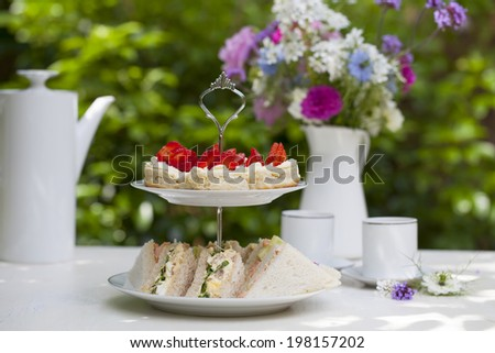 Afternoon tea in the garden - stock photo