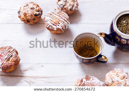 Afternoon tea with cakes on the table top view. Muffins on white vintage  table with black tea. The Time of Tea Break.  - stock photo
