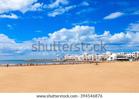 Agadir main beach in Agadir city, Morocco. Agadir is a major city in Morocco located on the shore of the Atlantic Ocean. - stock photo