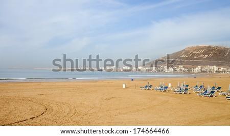 Agadir sand beach, Morocco.The inscription on the mountain - God, King, Country  - stock photo