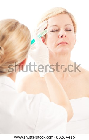 Age and beauty; a doctor is doing the injection