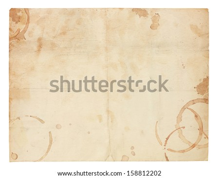 Aged and worn paper with creases, coffee ring stains and smudges. Includes clipping path. - stock photo