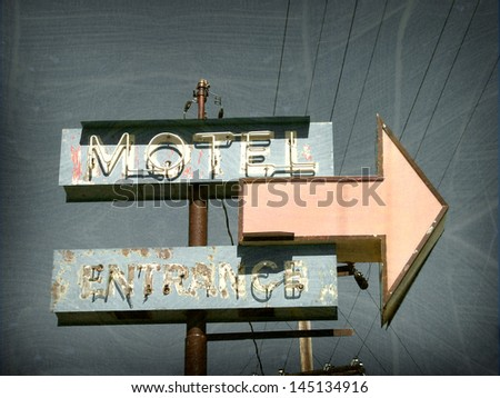 aged and worn vintage neon motel sign - stock photo