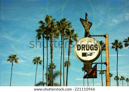 aged and worn vintage photo of drugs sign and palm trees - stock photo