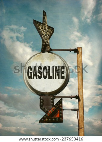 aged and worn vintage photo of gasoline sign - stock photo