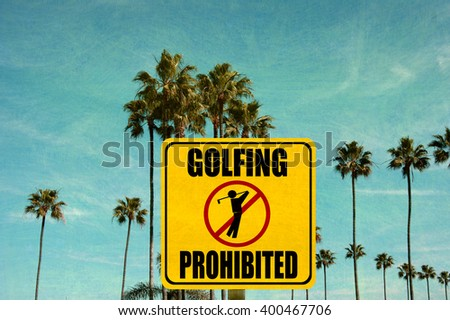 aged and worn vintage photo of golfing prohibited sign with palm trees - stock photo