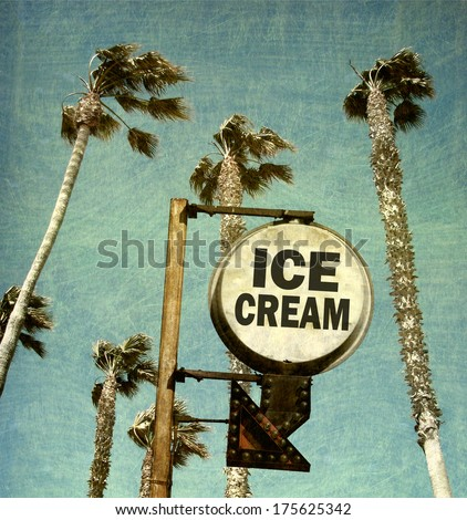 aged and worn vintage photo of ice cream sign and palm trees - stock photo