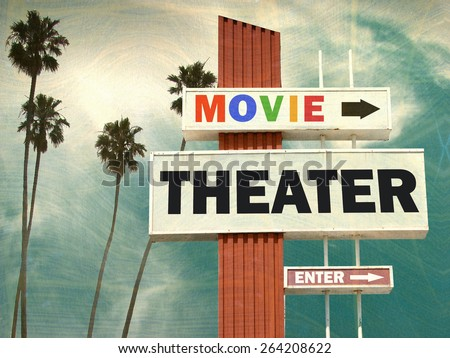 aged and worn vintage photo of movie theater sign with palm trees - stock photo