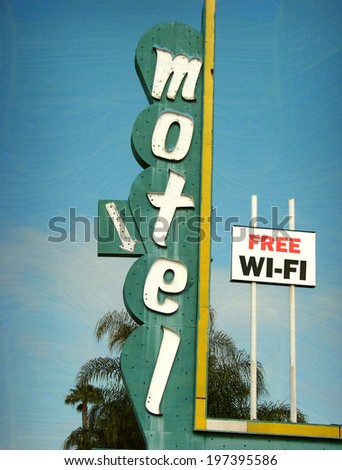 aged and worn vintage photo of neon motel sign with free wi-fi internet                               - stock photo