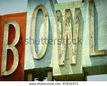 aged and worn vintage photo of old demolished bowling alley sign - stock photo
