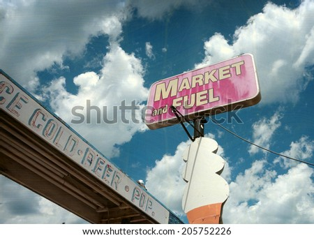 aged and worn vintage photo of old market sign and big ice cream cone                     - stock photo