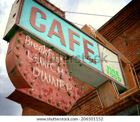 aged and worn vintage photo of old neon cafe sign - stock photo
