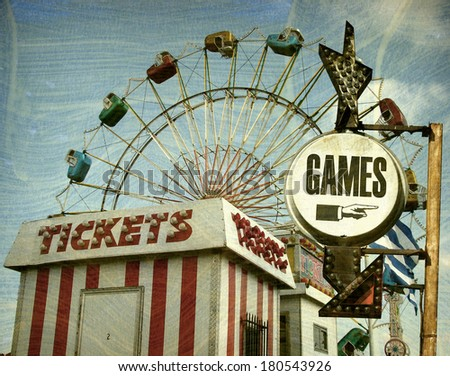 aged and worn vintage photo of retro carnival with games sign                                 - stock photo