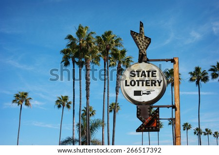 aged and worn vintage photo of state lottery sign                               - stock photo