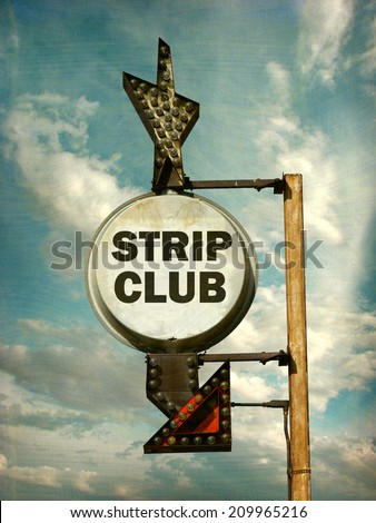 aged and worn vintage photo of strip club sign                                - stock photo