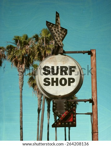 aged and worn vintage photo of surf shop sign with palm trees - stock photo