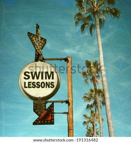 aged and worn vintage photo of swim lessons sign with palm trees - stock photo
