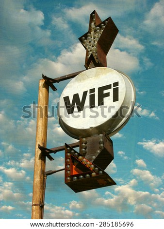 aged and worn vintage photo of wifi sign                            - stock photo
