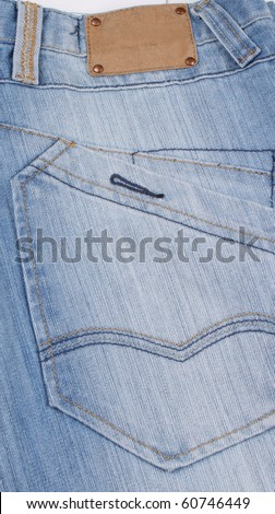 Aged blank leather patch on the back of a pair of jeans.