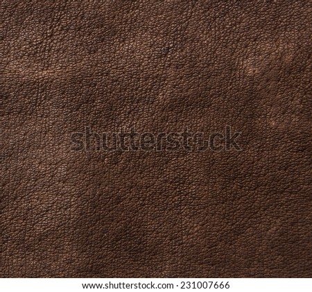 Aged brown real natural shabby dark brown leather background close-up  - stock photo