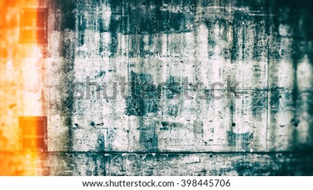 Aged concrete background pattern with lens flare effect.  Black and white wall with orange light on left side of image and blurred corners - stock photo