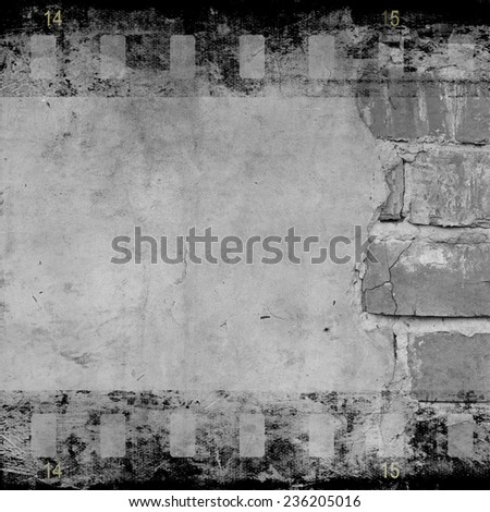 Aged cracked wall with film strip  - stock photo