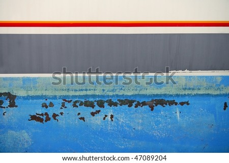 Aged grunge boat iron rusty hull old blue paint surface - stock photo