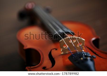 aged handmade violin on dark background - stock photo