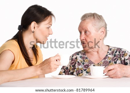 aged mom with her daughter at table