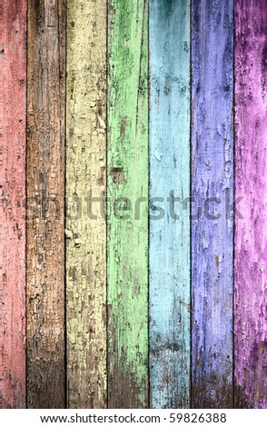 aged rainbow painted wooden fence, naturally weathered - stock photo