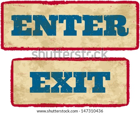 Aged retro enter and exit sign boards